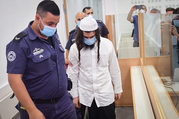 Amiram Ben-Uliel, who was charged with murder over the Duma arson attack in July 2015, arrives to hear his verdict at the Lod District Court, May 18, 2020. (Flash90)