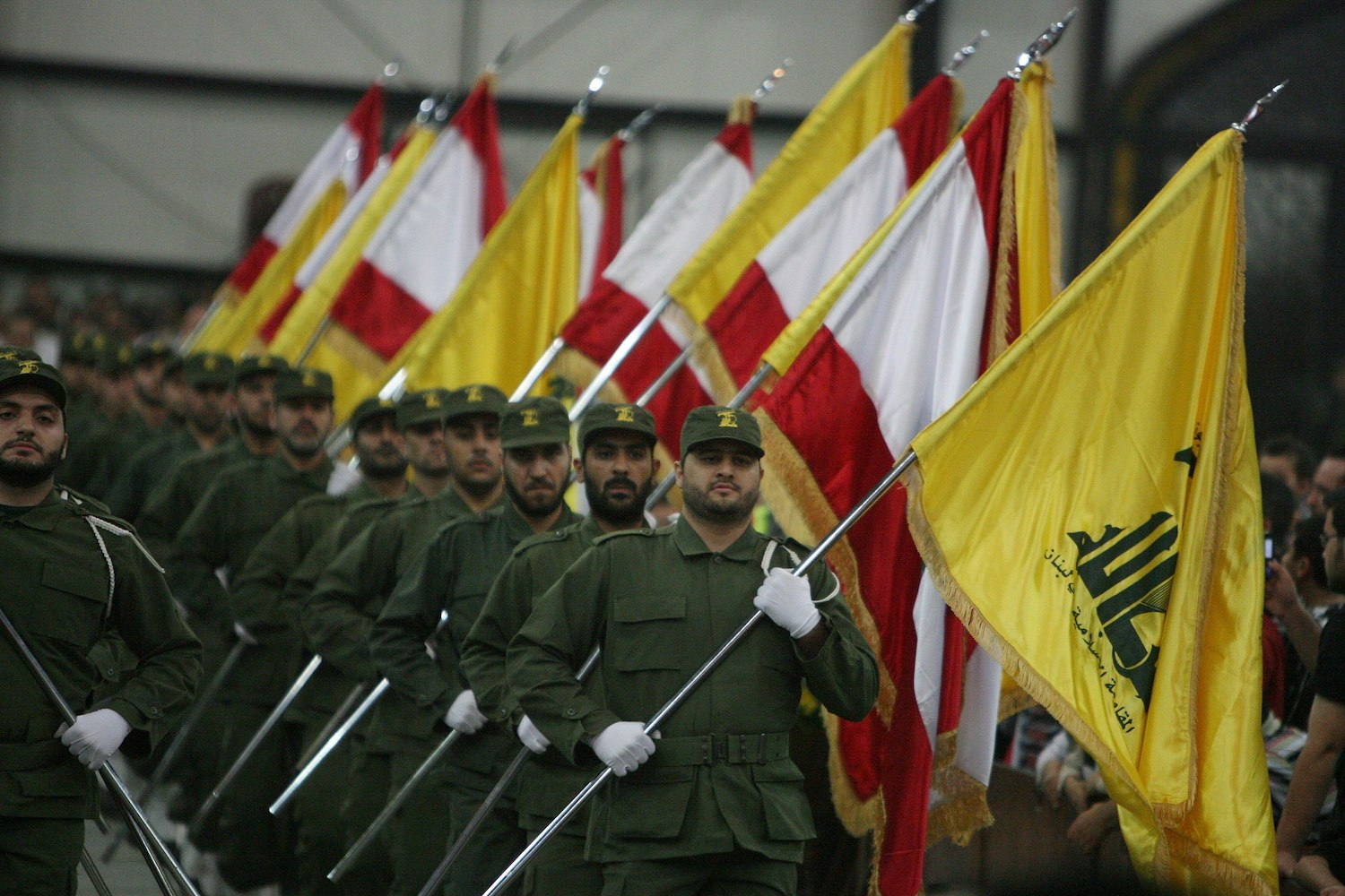 Hezbollah fighters march during a ceremony. (khamenei.ir/CC BY 4.0)
