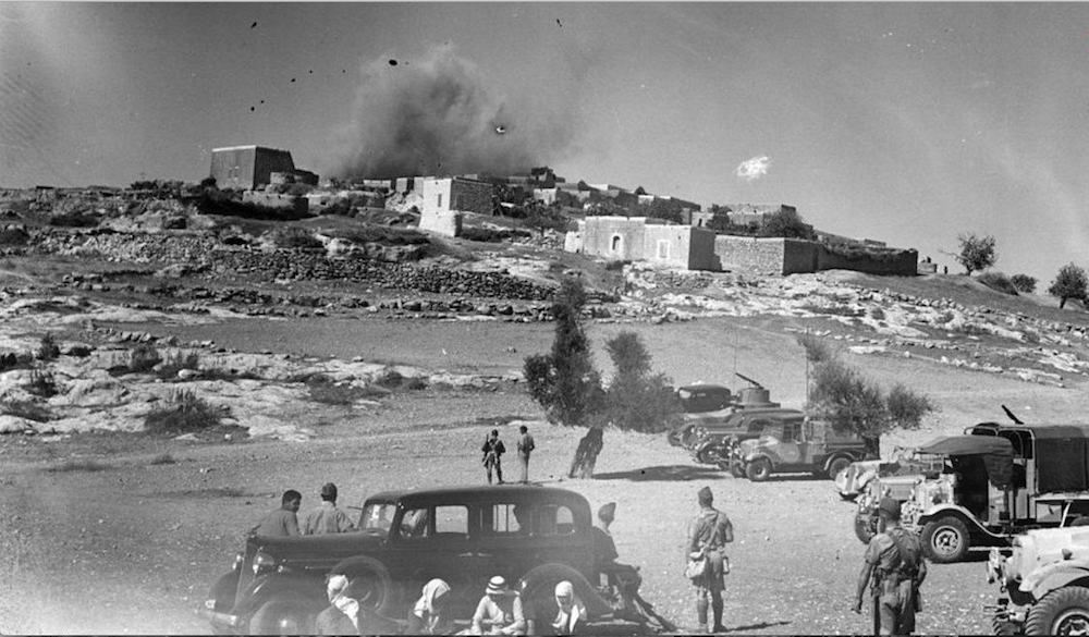 The Palestinian village of Mi'ar seen blown up by British forces during the Arab Revolt, 1938.