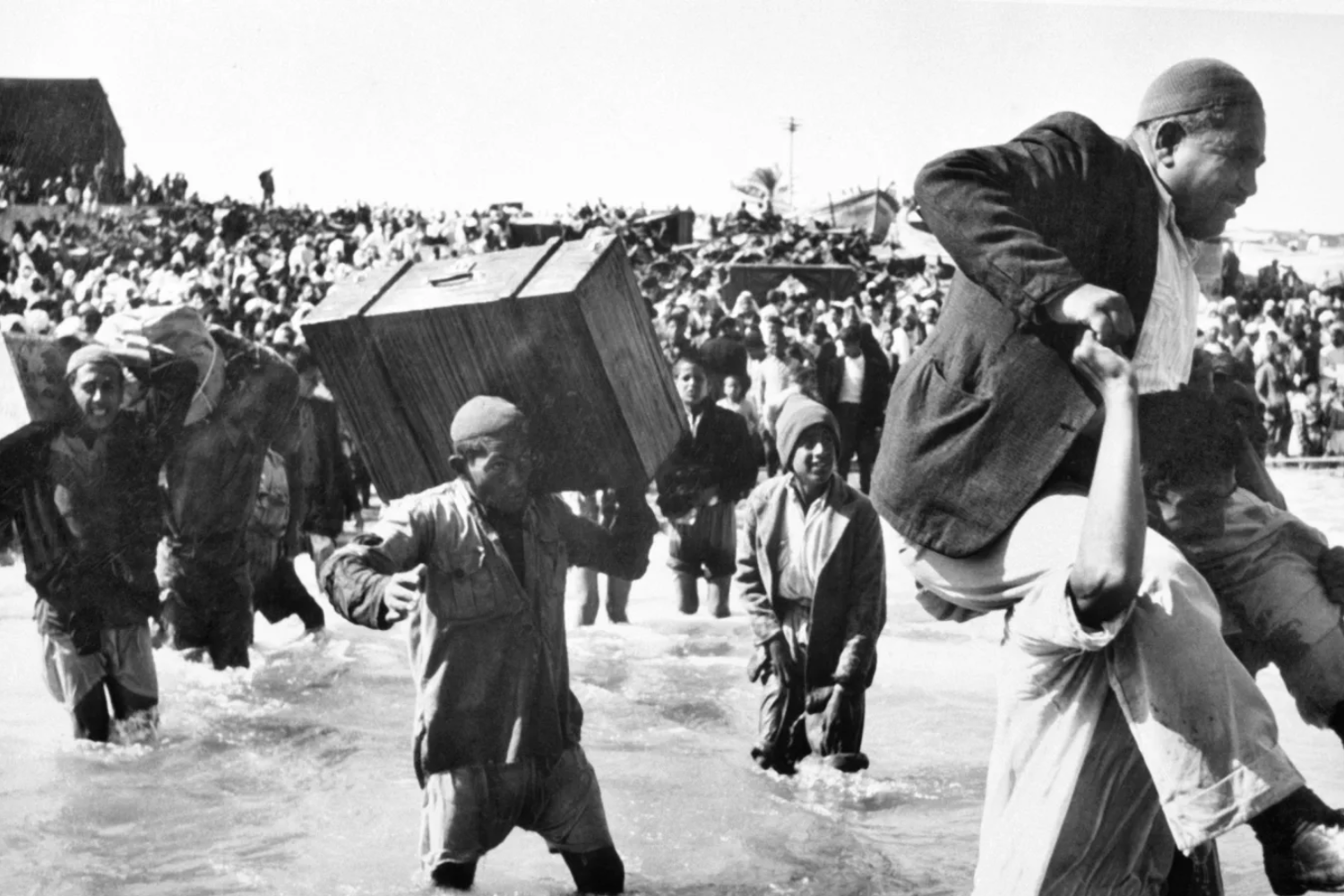 Palestine refugees initially displaced to Beach camp in Gaza board boats to Lebanon or Egypt during the first Arab-Israeli war, 1949 (UN Archives Photo/Hrant Nakashian)