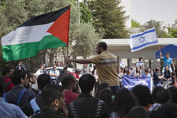 Palestinian students at the Hebrew University of Jerusalem protest a violent escalation that followed Nakba Day, while Jewish Israeli students counter-protest opposite them, May 16, 2011. (Ruben Salvadori/Flash 90)