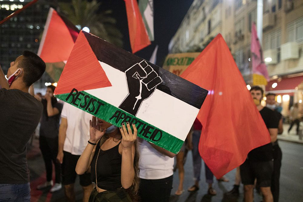 Jewish Israeli and Palestinian protesters take part in a demonstration in Rabin Square against the government's annexation plan, Tel Aviv, June 6, 2020. (Oren Ziv)
