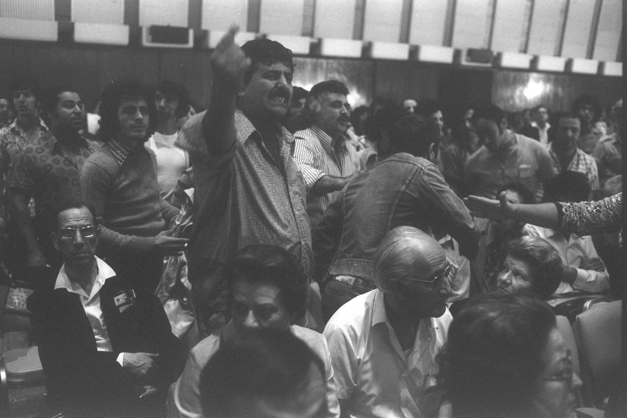 Members of the Israeli Black Panthers disrupt the opening session of the World Congress of North African Immigrants in Tel Aviv, October 25, 1975. (Ya'acov Sa'ar)