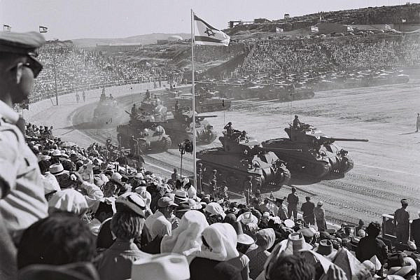 Israelis look on at an Independence Day military parade at the Hebrew University Stadium, Jerusalem, April 24, 1958. (GPO)