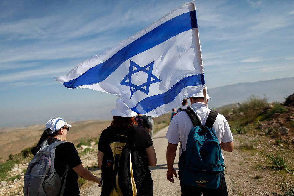 Israelis take part in an annual 8-km march in the Jordan Valley, led by then-Interior Affairs Minister Gideon Saar. February 21, 2014. (Yonatan Sindel/FLASH90)