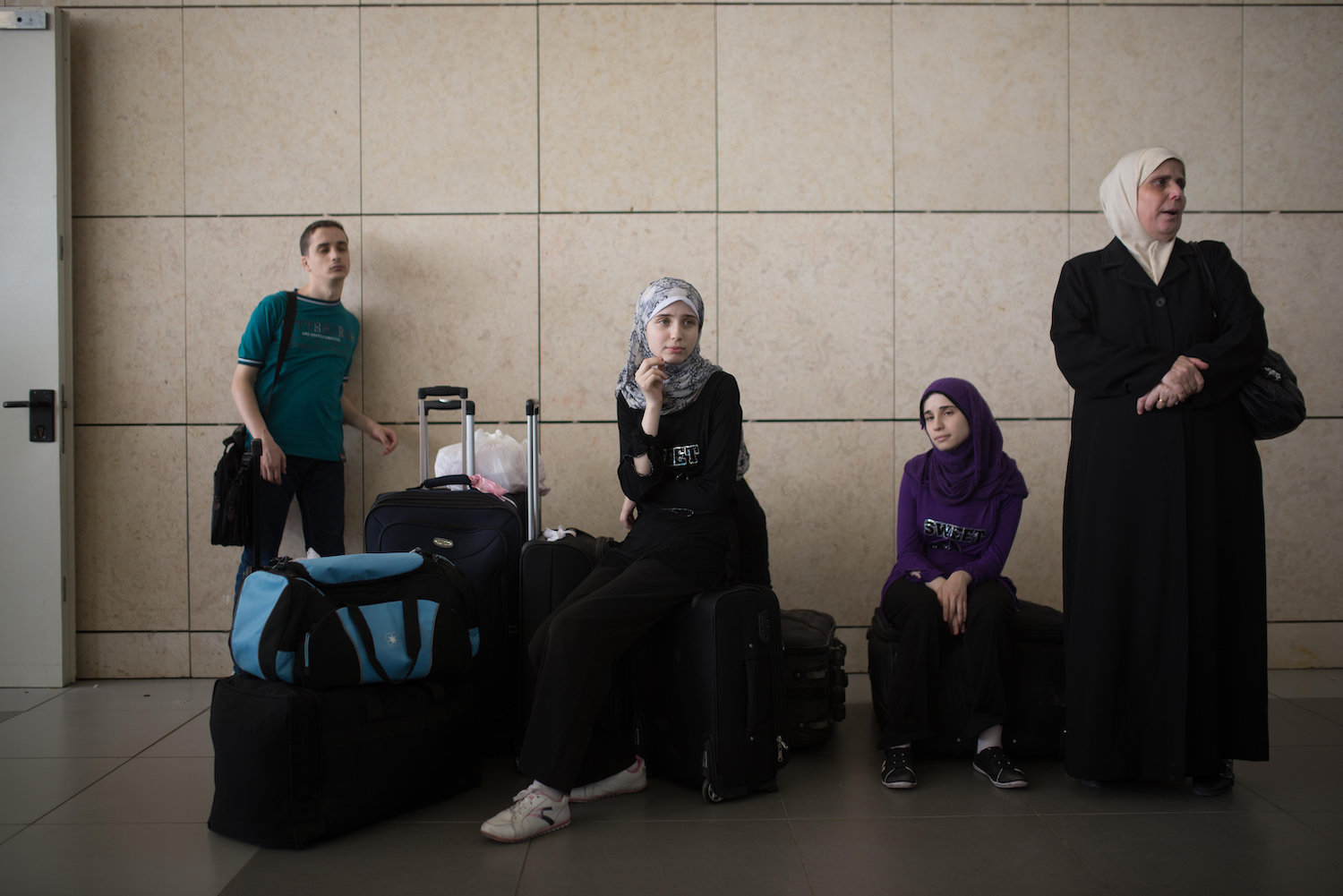 Palestinians wait at the Erez crossing between Gaza and Israel on July 13, 2014. (Flash90)
