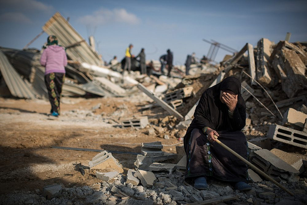 A Bedouin woman reacts after seeing her demolished home in the village of Umm al-Hiran in the Negev desert, in southern Israel, January 18, 2017. (Hadas Parush/Flash90)