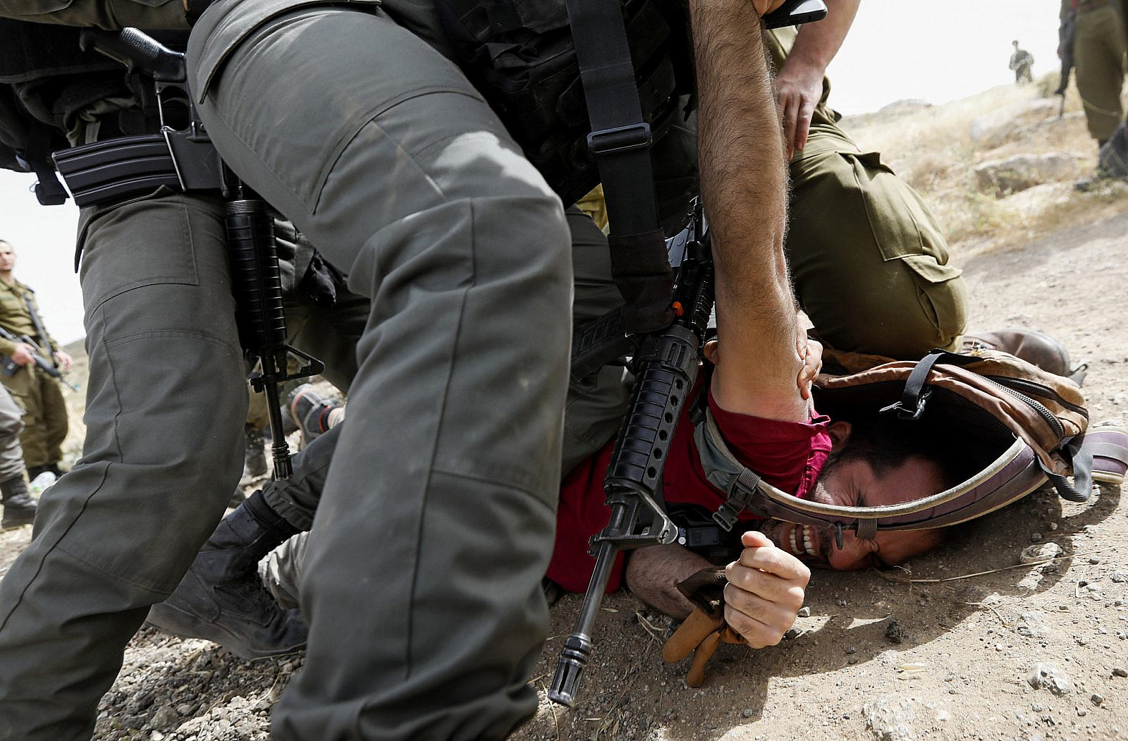 Israeli troops arrest activists during a protest against the demolition of Palestinian houses near the West Bank village of Yatta, south of Hebron, on May 3, 2019. (Wisam Hashlamoun/Flash90)
