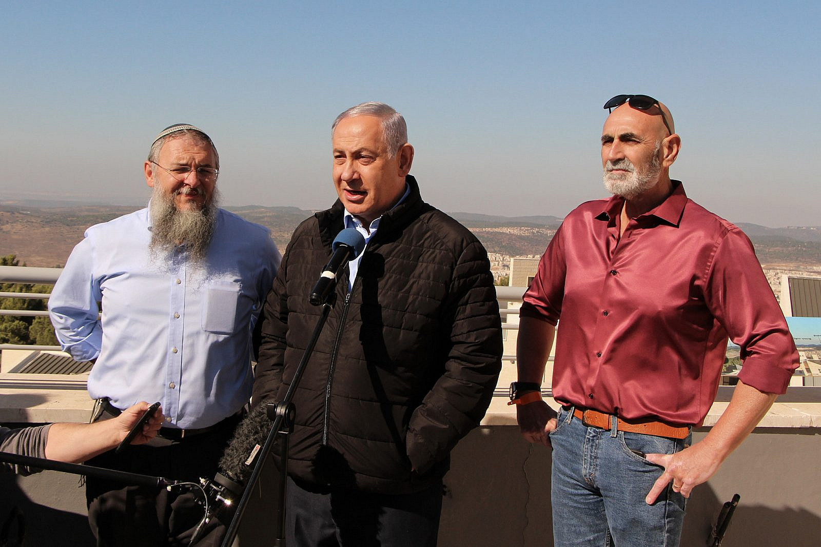 Prime Minister Benjamin Netanyahu with Gush Etzion Regional Council Chairman Shlomo Ne'eman, and Jordan Valley regional council chairman David Elchiani, as he visits the Jewish settlement of Alon Shvut in Gush Etzion, in the West Bank. November 19, 2019. (Gershon Elinson/Flash90)