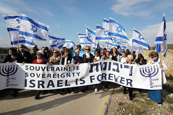 Likud supporters march alongside Israeli Minister of Diaspora Affairs Tzipi Hotovely in the Gush Etzion settlement in the occupied West Bank to demand Israel annex the West Bank, February 27, 2020. (Gershon Elinson/ Flash90)