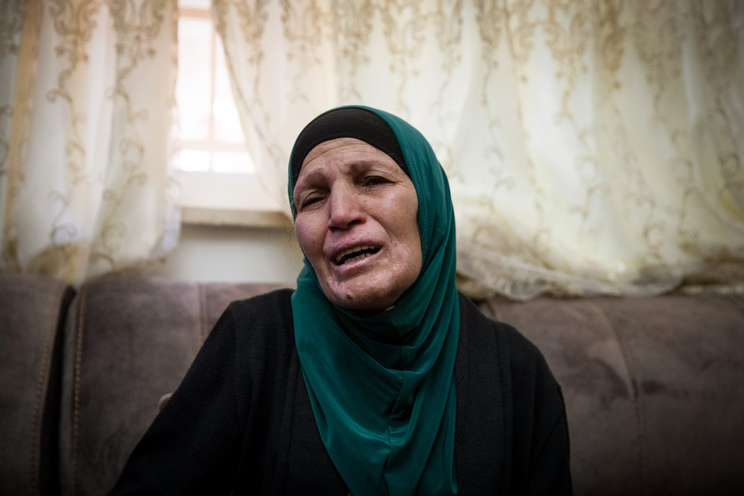 The mother of a Iyad al-Hallaq, who was shot dead by police in the Old City of Jerusalem, speaks with the media at her family home in the East Jerusalem neighborhood of Wadi Joz, May 30, 2020. (Yonatan Sindel/Flash90)