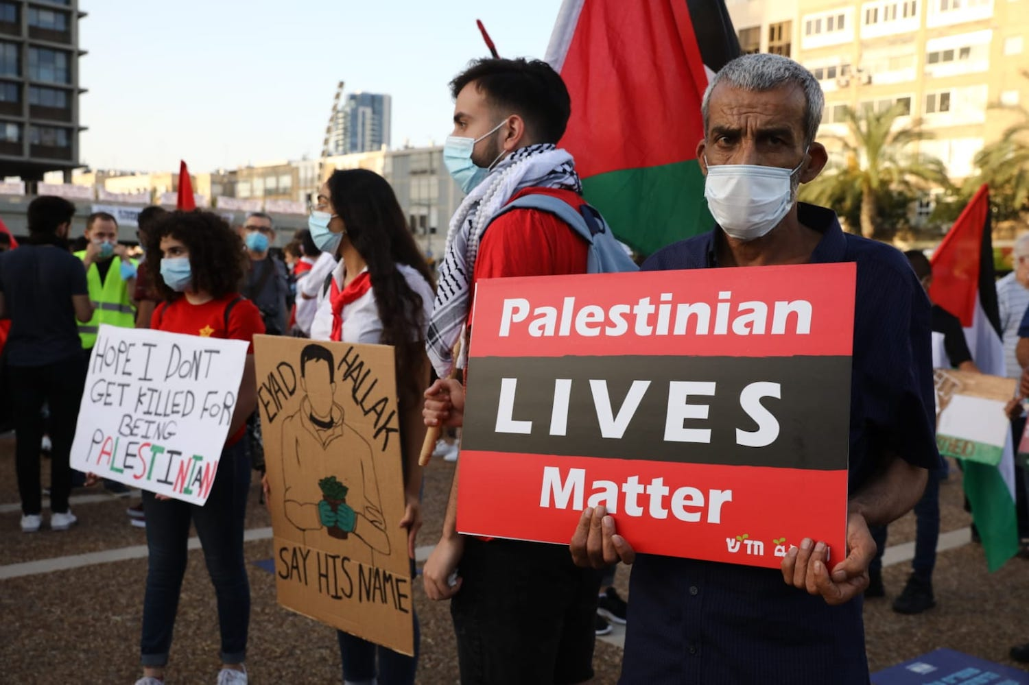 Israeli and Palestinian protesters take part in a demonstration in Rabin Square against the government's annexation plan, Tel Aviv, June 6, 2020. (Oren Ziv)
