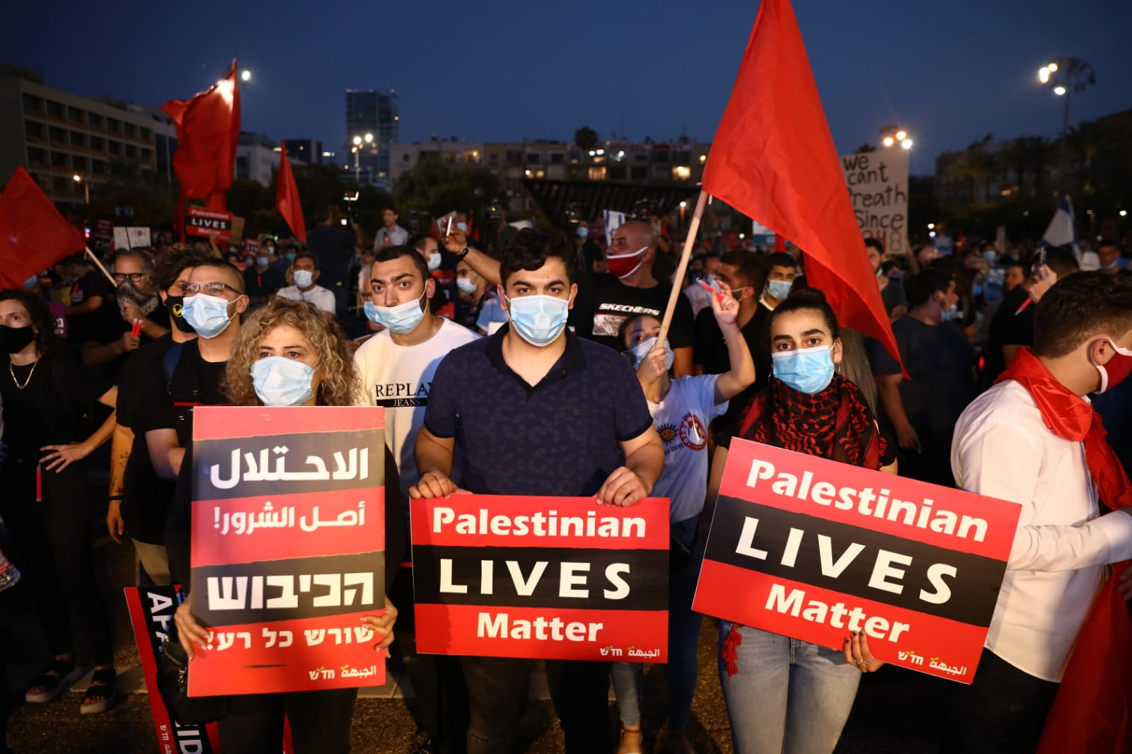 Thousands of Israeli and Palestinian protesters take part in a demonstration in Rabin Square against the government's annexation plan, Tel Aviv, June 6, 2020. (Oren Ziv)