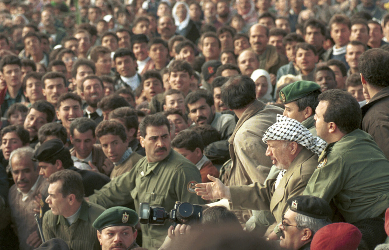 Palestinian president Yasser Arafat is cheered on by supporters as he visits the city of Hebron in the occupied West Bank, January 19, 1997. (Nati Shohat/Flash90)