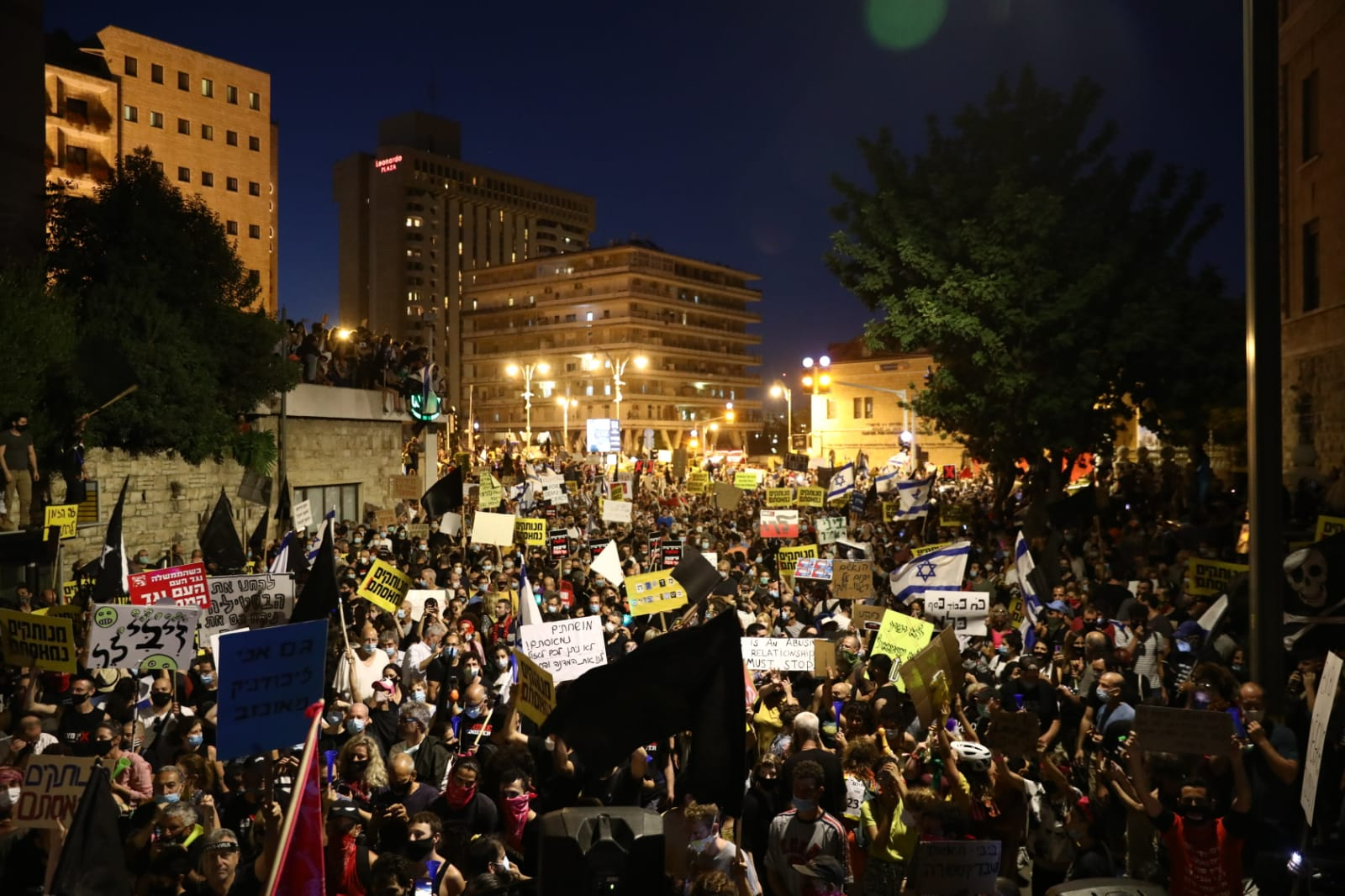 Thousands take part in a mass demonstration outside the Prime Minister's Residence in Jerusalem, demanding Benjamin Netanyahu step down over his corruption scandals, July 14, 2020. (Oren Ziv)