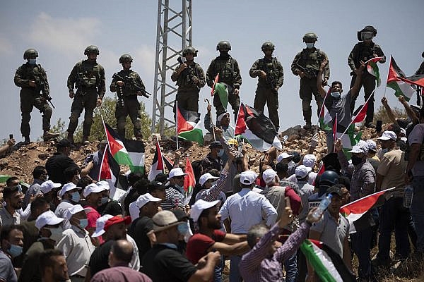 Palestinians protest against the establishment of a new Israeli settlement outpost near the town of Asira a-Shamaliyain the northern West Bank, July 10, 2020. (Oren Ziv/Activestills)