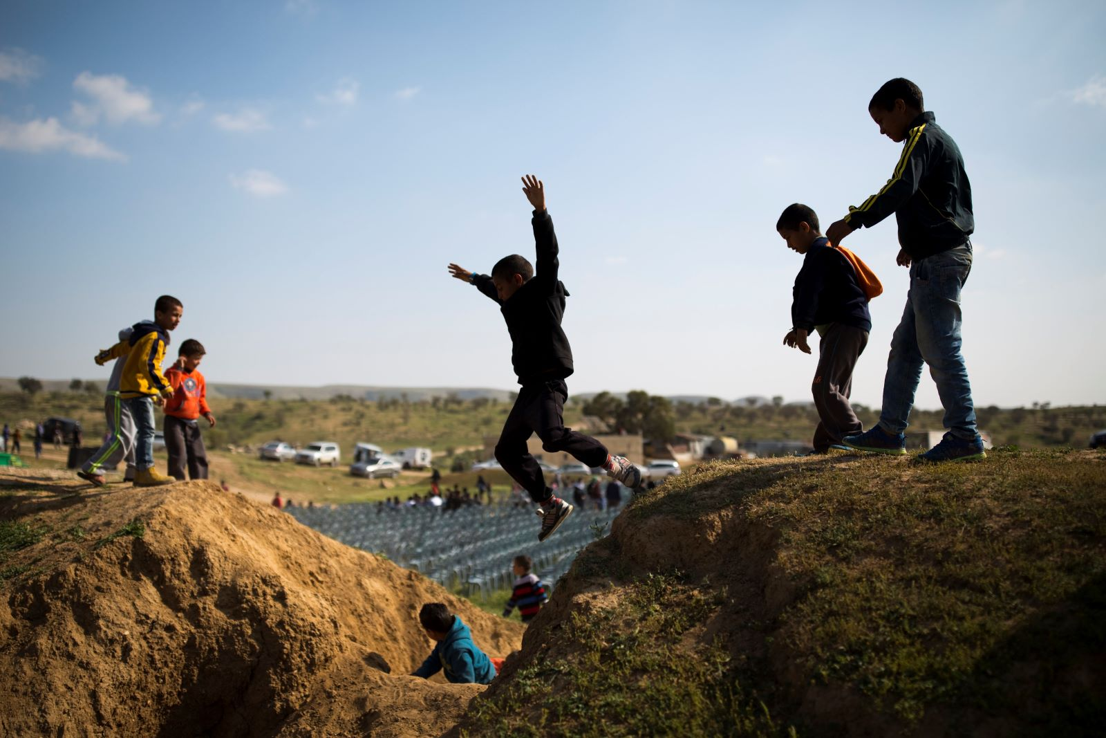 Arab Bedouin kids play near a protest marking the 40th anniversary of Land Day, in Umm Al-Hiran, southern Israel, March 30, 2016. (Corinna Kern/Flash90)