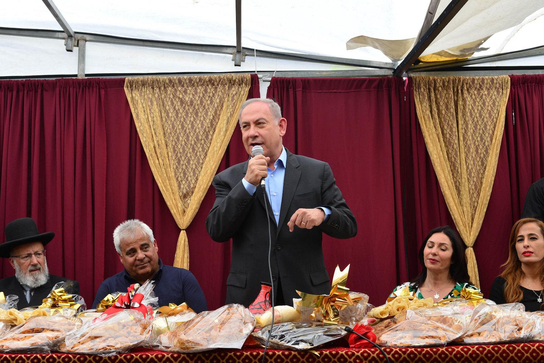 Israeli Prime Minister Benjamin Netanyau and former Culture Minister Miri Regev attend the Jewish Moroccan celebration of Mimouna, Dimona, April 18, 2017. (Kobi Gideon/GPO)
