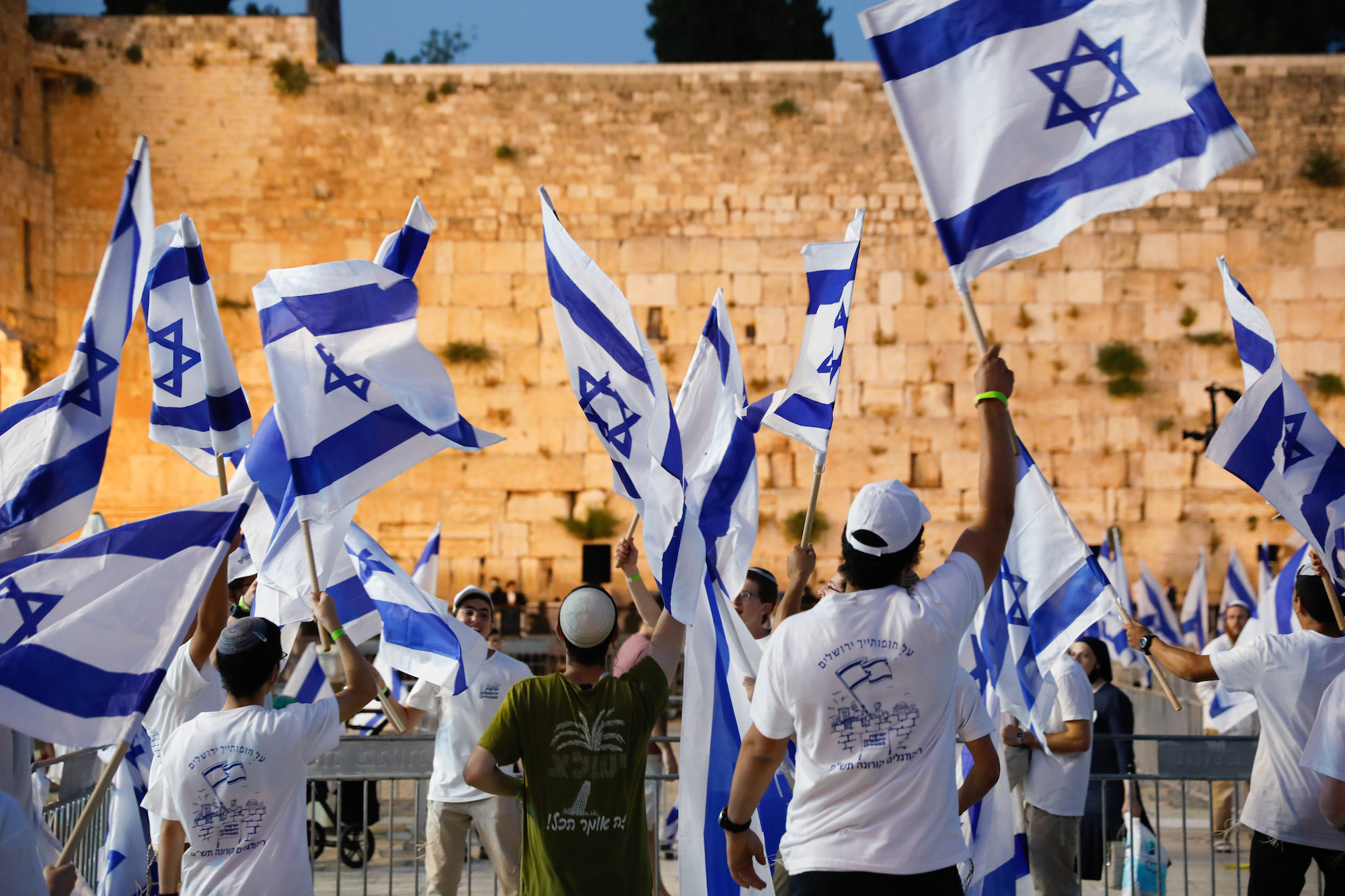 Young Jewish Israelis celebrate Jerusalem Day at the Western Wall in Jerusalem's Old City, May 21, 2020, marking 53 years since Israel occupied East Jerusalem. (Olivier Fitoussi/Flash90)