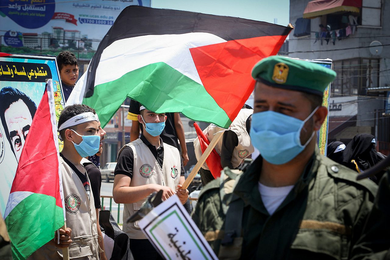 Hundreds of members of Palestinian security services and different political factions participate in a protest against the Israeli annexation plans in the West Bank, Rafah, southern Gaza Strip, June 29, 2020. (Abed Rahim Khatib/Flash90)