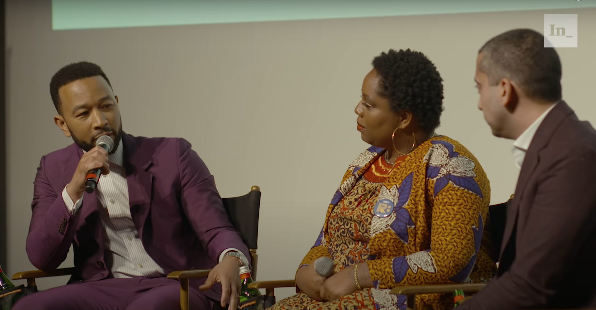Musician John Legend at a live taping of the Deconstructed podcast at the Writer's Guild Theater in Los Angeles, with host Mehdi Hasan and Patrisse Cullors, co-founder of the Black Lives Matter Global Network. (Screenshot from The Intercept's Youtube channel)