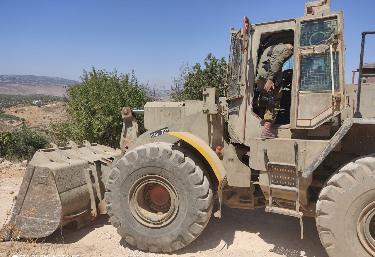 A bulldozer at the new Israeli settlement outpost near the town of Asira a-Shamaliyain the northern West Bank, July 10, 2020. (Oren Ziv/Activestills)