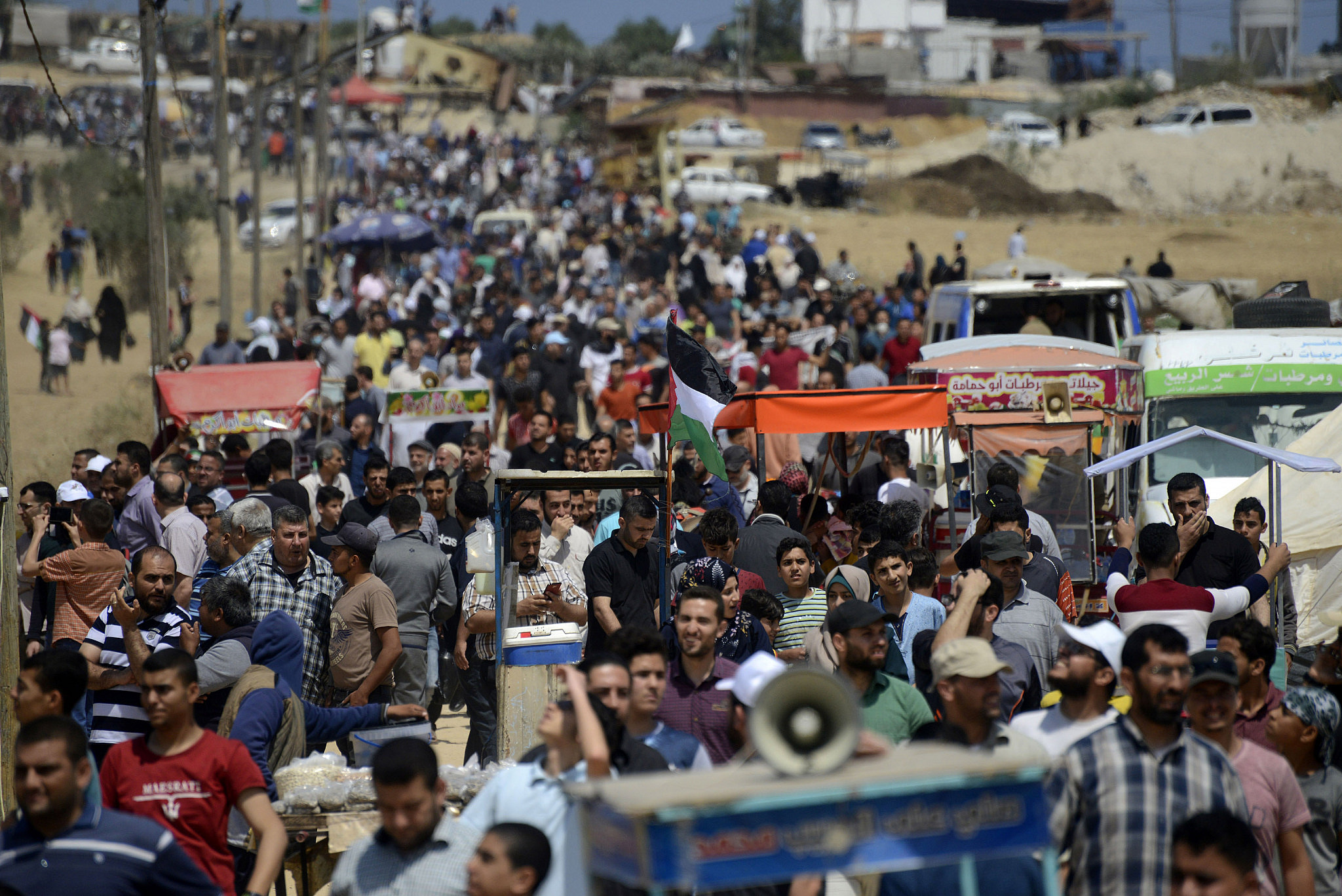 Thousands of Palestinians march toward the the Gaza-Israel fence during a Great Return March demonstration east of Gaza City, May 14, 2018. (Mohammad Zaanoun)