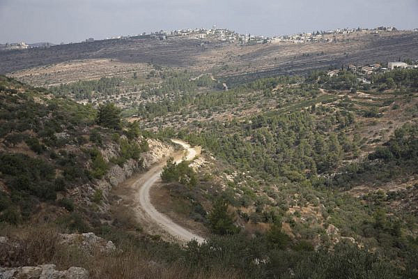 A stretch of Road 935 that was paved before the Second Intifada on Palestinian land in Deir Ibzi', August 20, 2020.