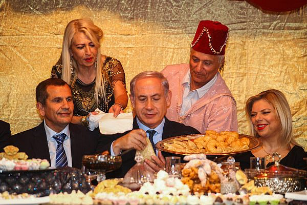 Prime Minister Benjamin Netanyau and his wife Sara attend the Jewish Moroccan Mimouna celebrations, Or Akiva, April 21, 2014. (Avishag Shaar Yashuv/Flash90)