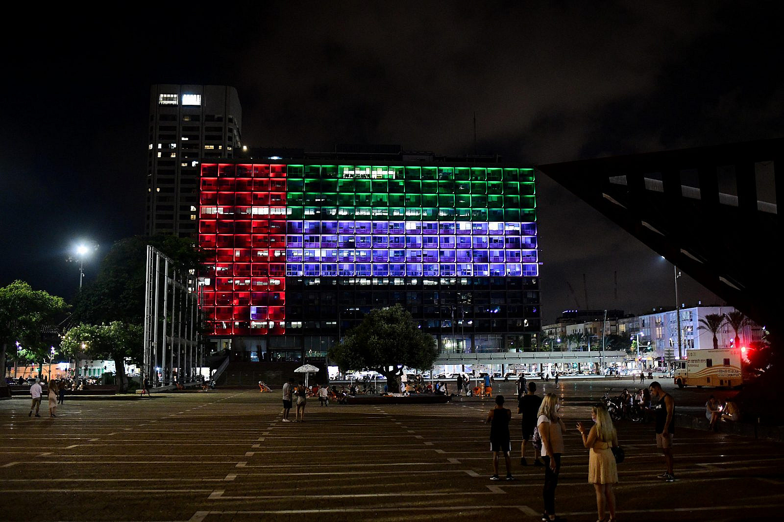 The Tel Aviv Municipality on Rabin square is lit up with the United Arab Emirates flag, on August 13, 2020. (Avshalom Sassoni/Flash90)