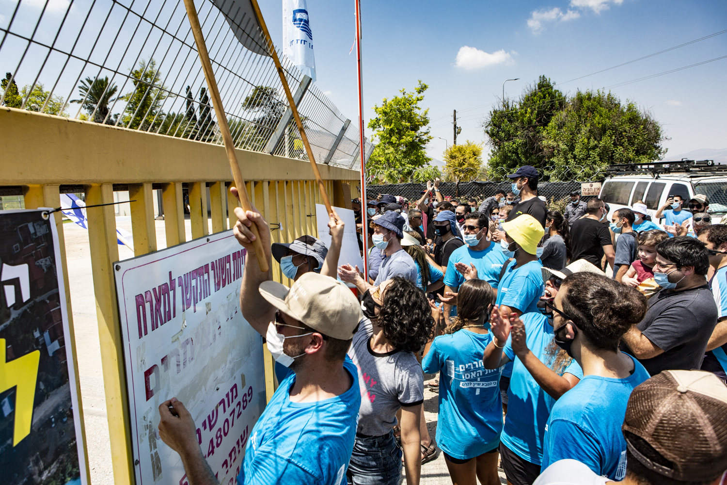 Activists and supporters demonstrate outside the main gate of Nir David calling on the kibbutz to allow free public access to the Asi River on August 14, 2020. (Photo by Mati Milstein)