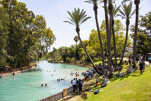 Israeli activists and supporters enter Kibbutz Nir David and swim in the Asi River for a couple of hours on August 14, 2020. (Photo by Mati Milstein)