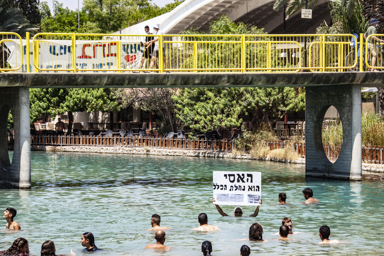 An activist holds a Hebrew sign that reads