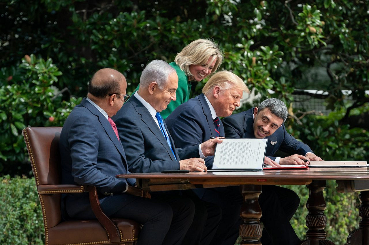 U.S. Chief of Protocol Cam Henderson assists President Donald Trump, Minister of Foreign Affairs of Bahrain Dr. Abdullatif bin Rashid Al-Zayani, Israeli Prime Minister Benjamin Netanyahu and Minister of Foreign Affairs for the United Arab Emirates Abdullah bin Zayed Al Nahyan with the documents during the signing of the Abraham Accords Tuesday, Sept. 15, 2020, on the South Lawn of the White House. (Official White House photo by Andrea Hanks)