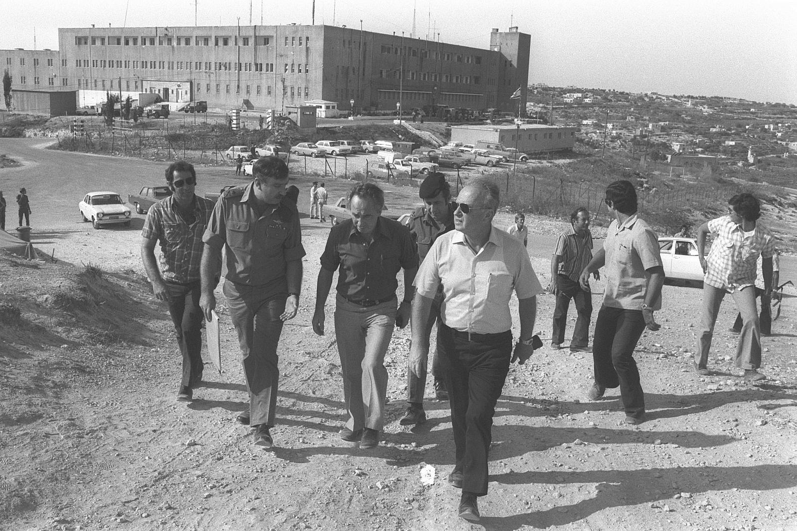 Israeli Prime Minister Yitzhak Rabin leaving a military headquarters after a visit to Hebron, October 15, 1976. (Saar Yaacov/GPO)