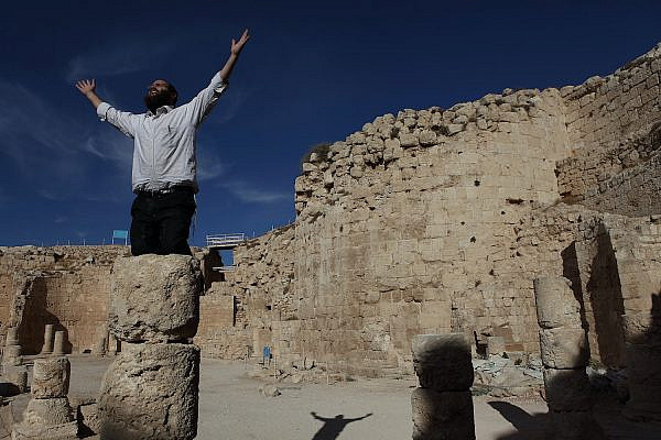 A Jewish ultra-Orthodox man visits the mountain fortress of Herodium, near the occupied West Bank city of Bethlehem, November 29, 2010. (Yaakov Naumi/Flash90)