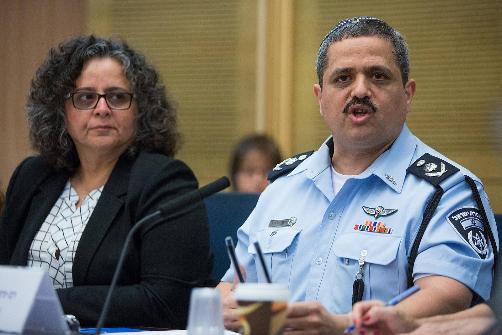 Joint List MK Aida Toma Sliman and Israeli Chief of Police Roni Alsheikh attend a Status of Women Committee meeting regarding sexual harassment in the Israeli police at the Knesset, March 29, 2016. (Yonatan Sindel/Flash90)