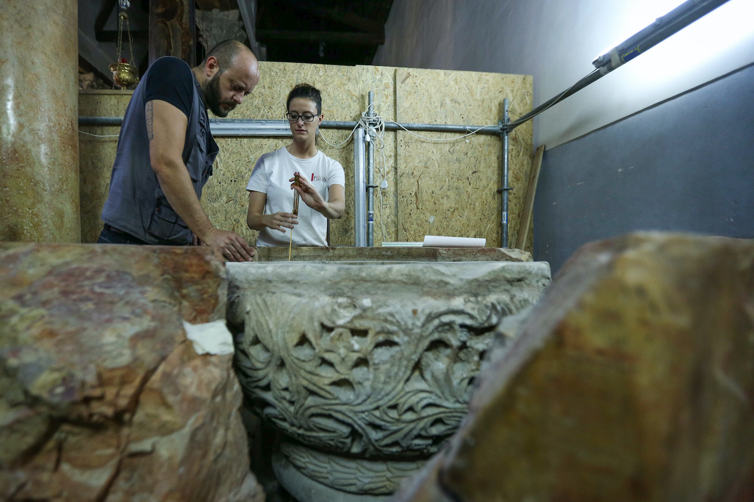 Archeologists present a Byzantine baptism font from the 6th century that was discovered during restoration work at the Church of the Nativity, in the occupied West Bank city of Bethlehem, June 22, 2019. (Wisam Hashlamoun/Flash90)