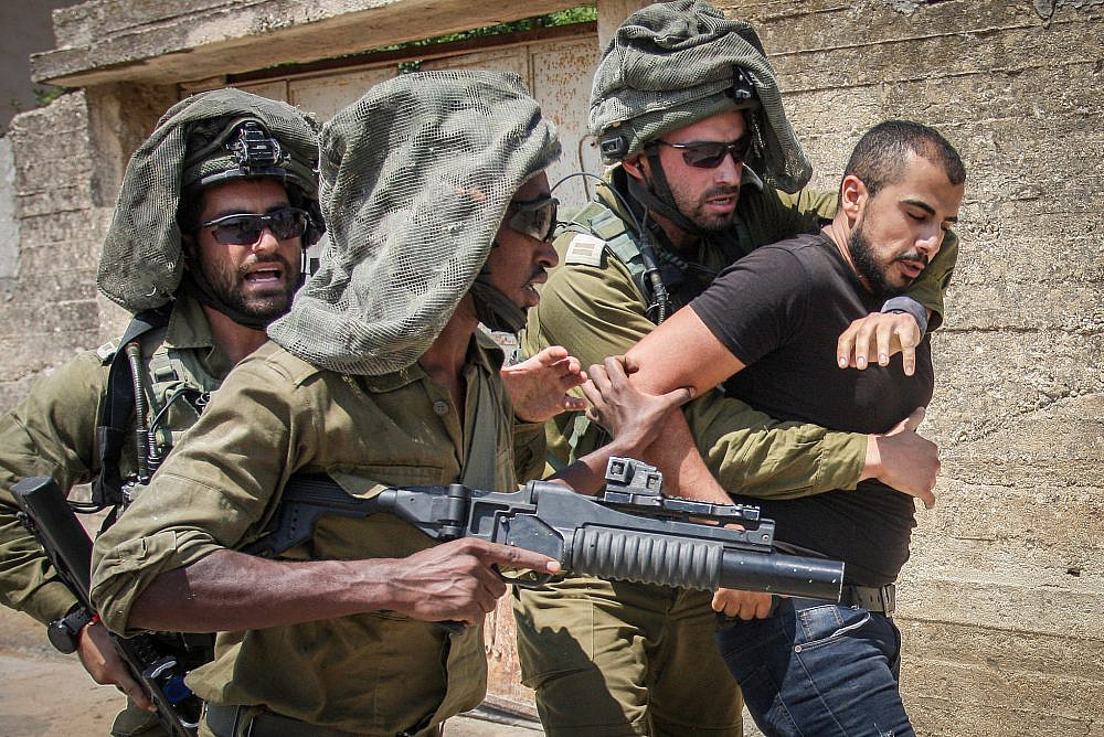 Israeli soldiers carry away a Palestinian protester in Kufr Qaddum, near Nablus in the occupied West Bank, August 23, 2019. (Nasser Ishtayeh/Flash90)