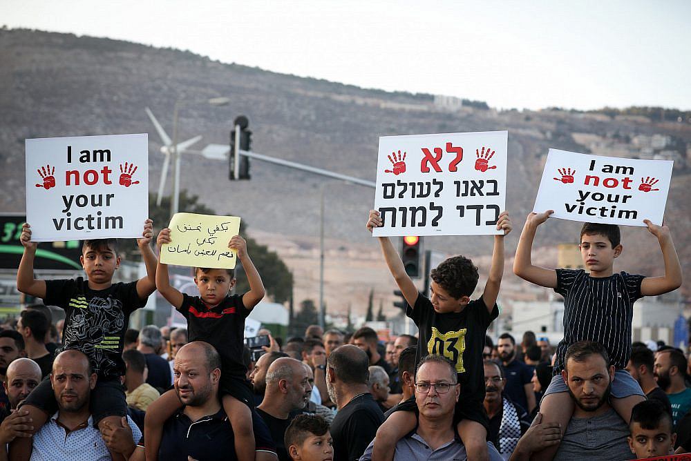 Palestinian citizens of Israel protest against violence, organized crime, and recent killings in their communities, in the Arab town of Majd al-Krum, northern Israel, October 3, 2019. (David Cohen/Flash90)