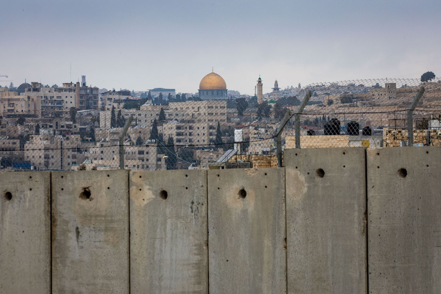 View of the separation wall and Al-Aqsa compound in the background on February 2, 2020. (Olivier Fitoussi/Flash90)