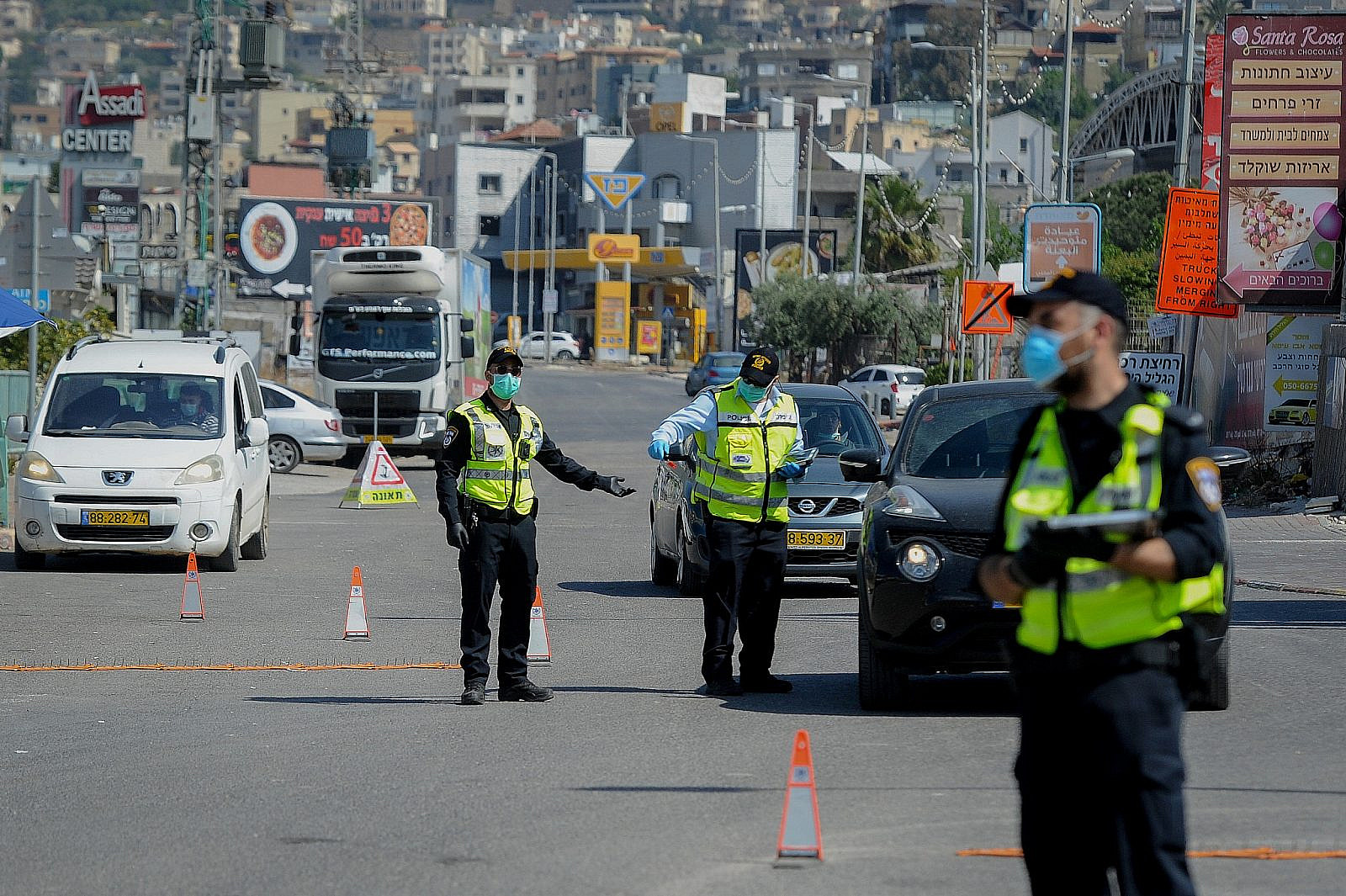 """Police at a temporary """"checkpoint"""" in the northern Arab town of Deir al-Asad, following the government decision on a full lockdown on the town, April 18, 2020. (Basel Awidat/Flash90)"""