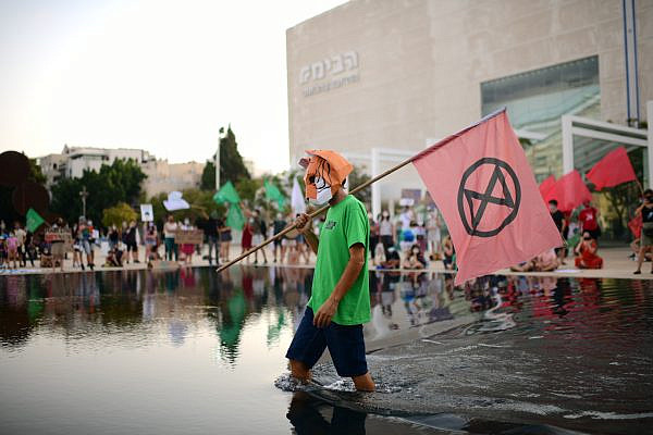 Israelis attend a rally calling for action against the climate crisis and the ecological crisis at Habima Square, Tel Aviv, July 26, 2020. (Tomer Neuberg/Flash90)
