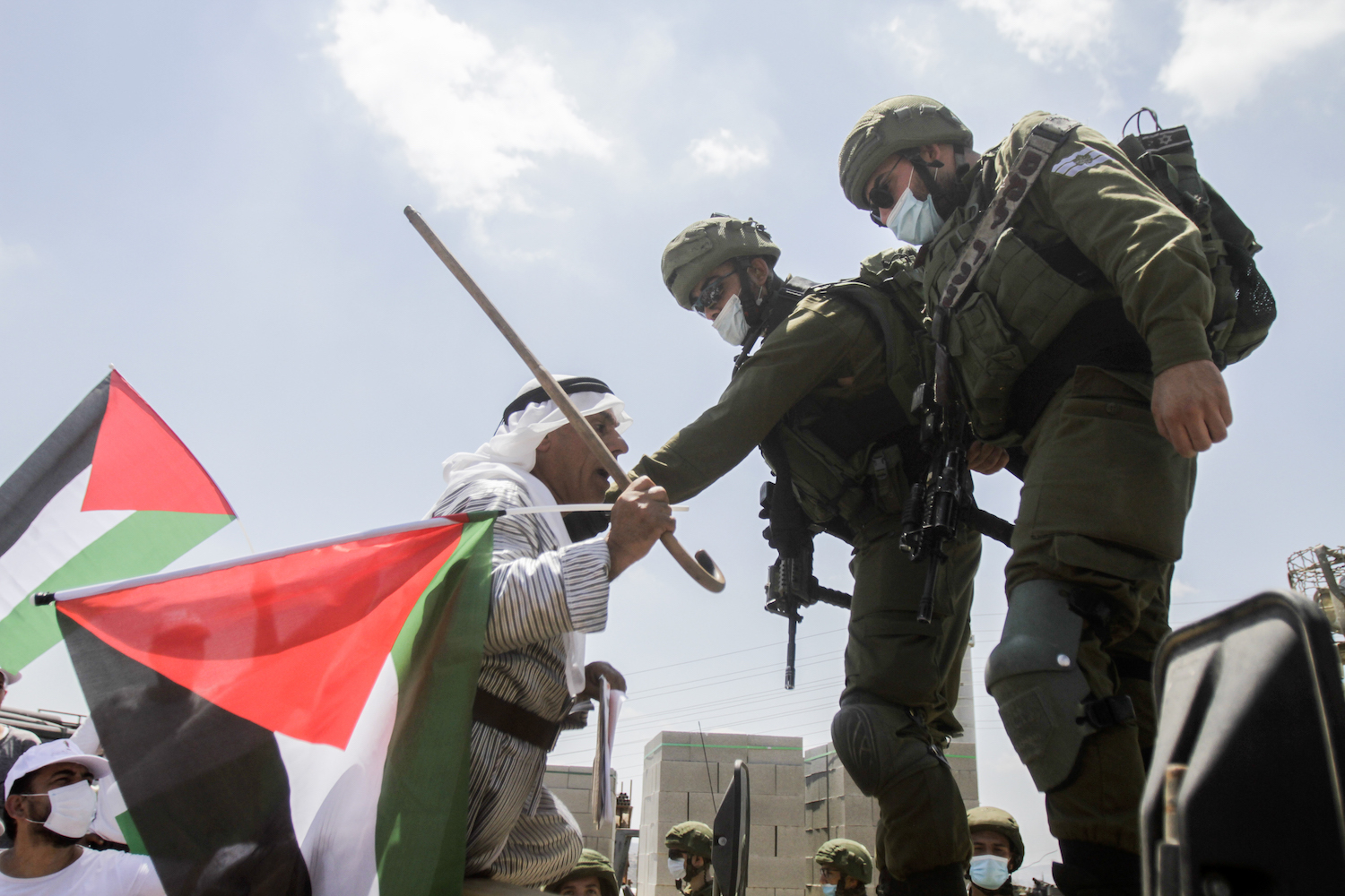 Palestinians protest against the deal between Israel and the UAE in the village of Haris, near the West Bank city of Nablus, August 14, 2020. (Nasser Ishtayeh/Flash90)