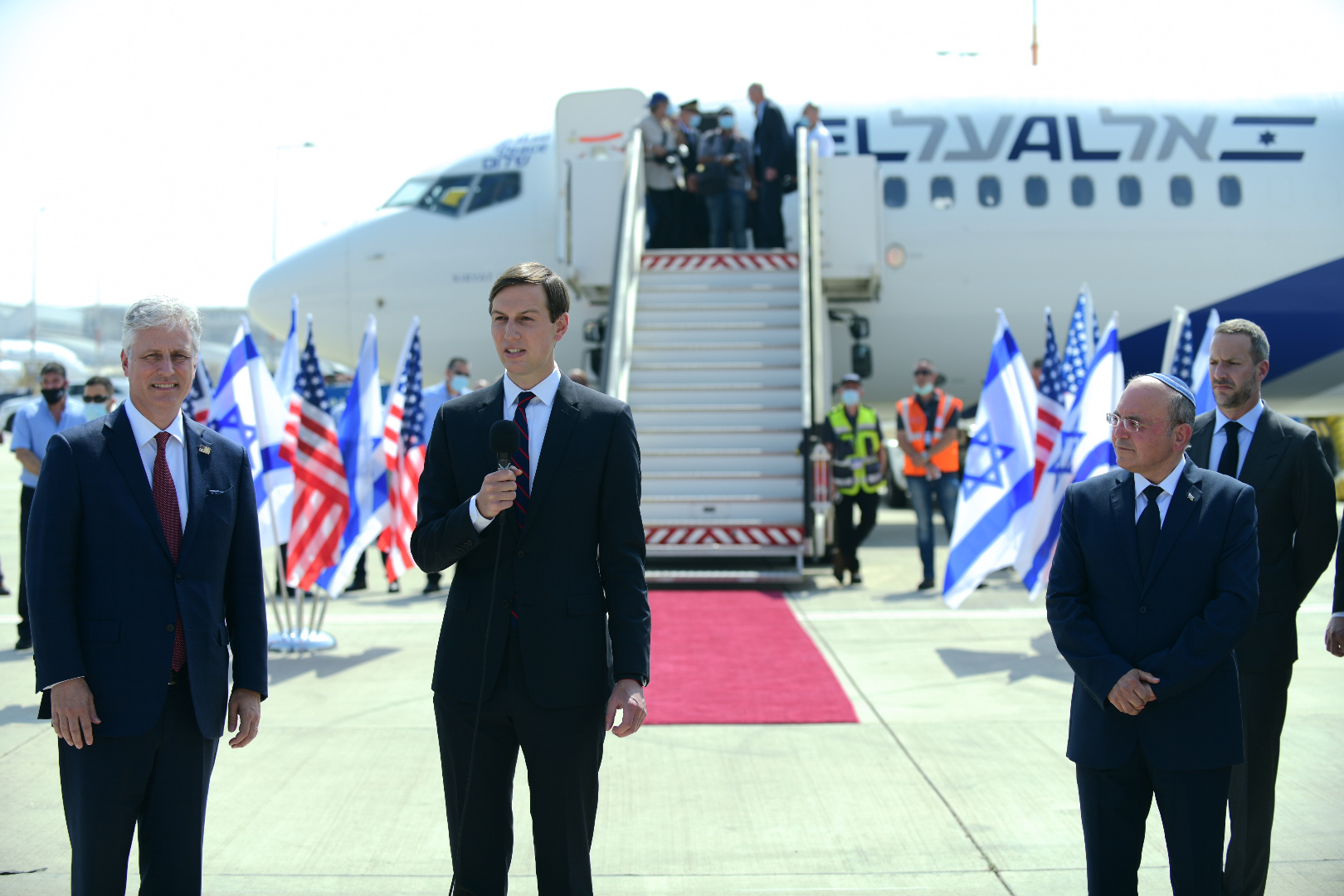 U.S. Presidential Adviser Jared Kushner, National Security Adviser Robert OBrien, and members of the US-Israeli delegation attend a ceremony ahead of their departure from Tel Aviv to Abu Dhabi, at the Ben-Gurion Airport near Tel Aviv, August 31, 2020. (Tomer Neuberg/Flash90)