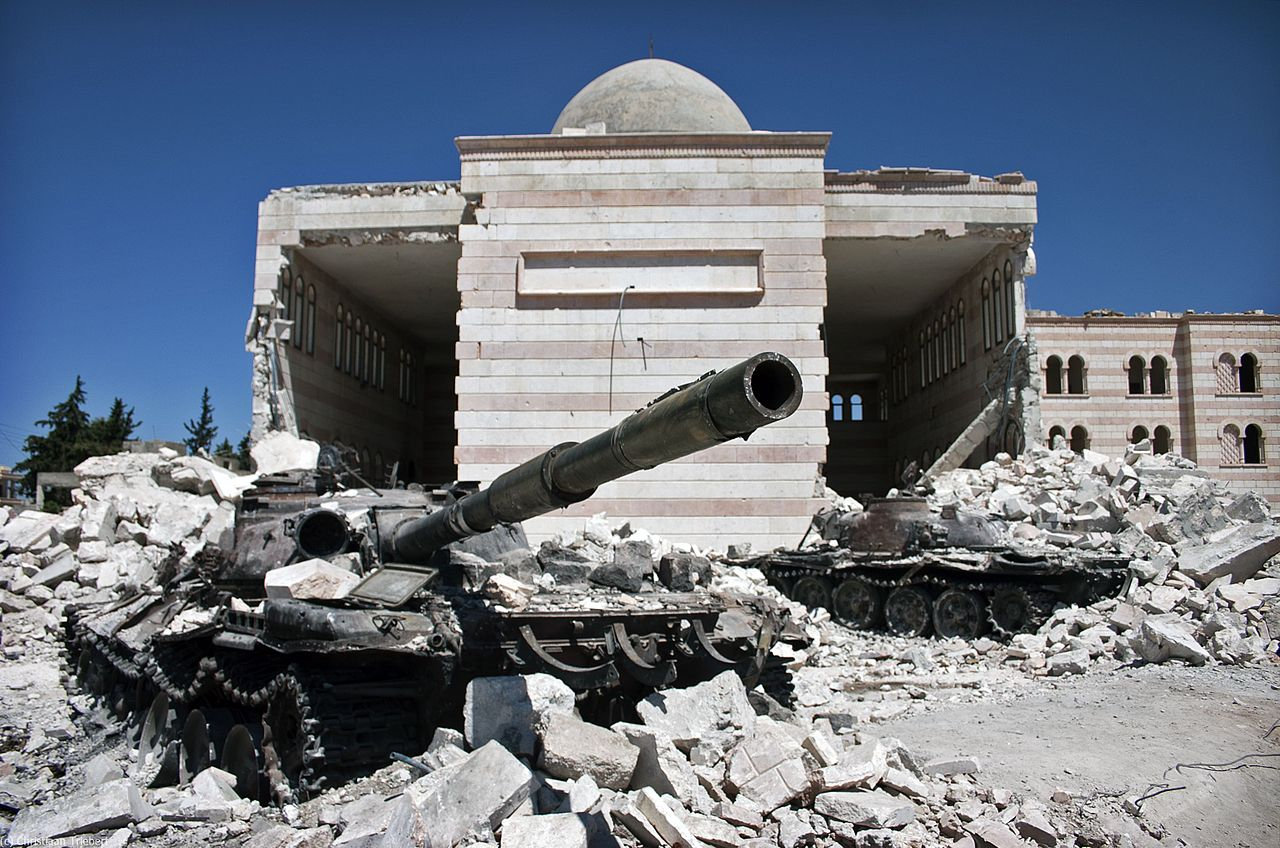 Two destroyed tanks in front of a mosque in Azaz, north of Aleppo in Syria, following a battle between the Free Syrian Army and the Syrian government. (Christiaan Triebert/Wikimedia Commons)