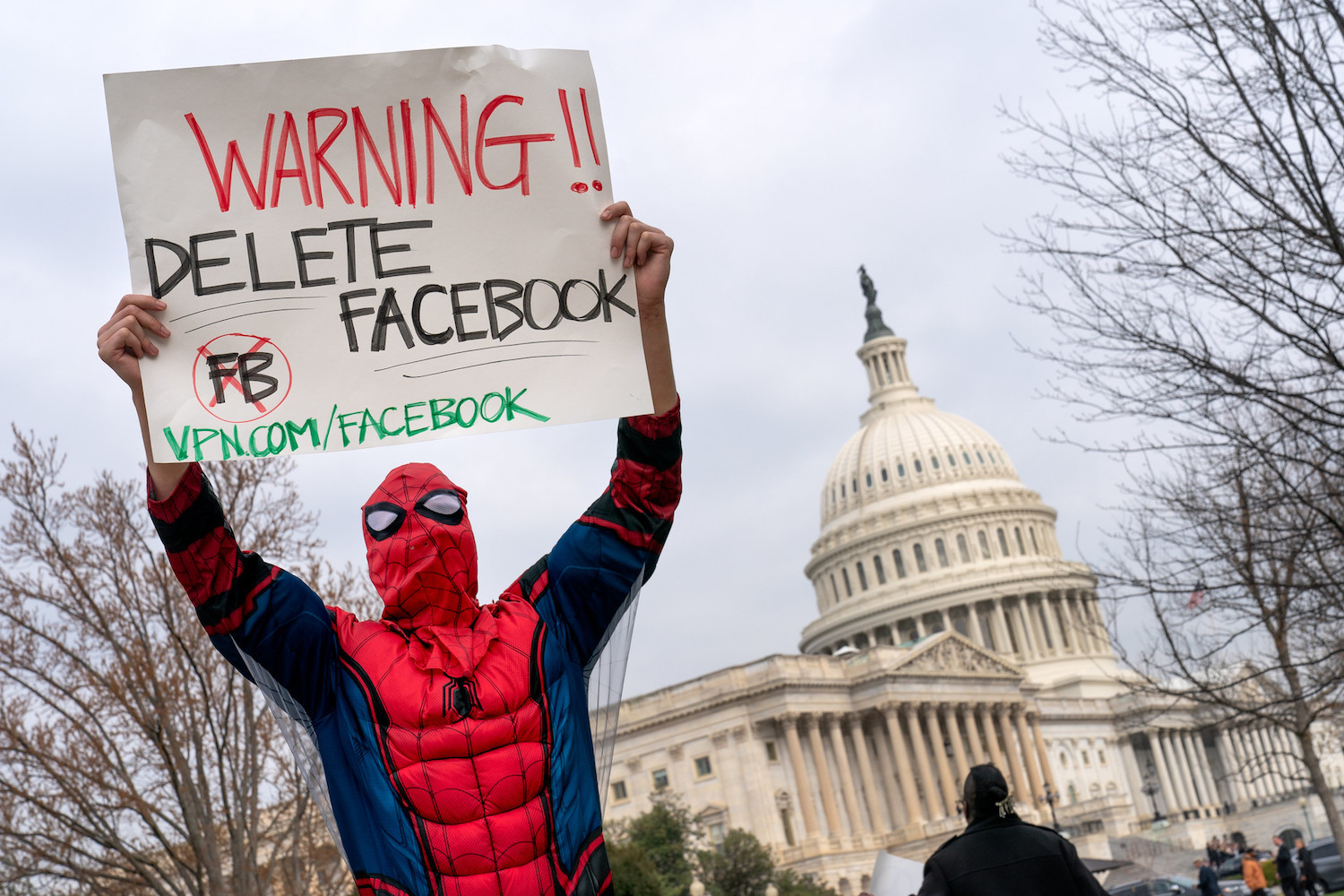 A protester dressed as Spiderman demonstrates against Facebook, Washington DC. (Lorie Shaull/CC BY-SA 2.0)