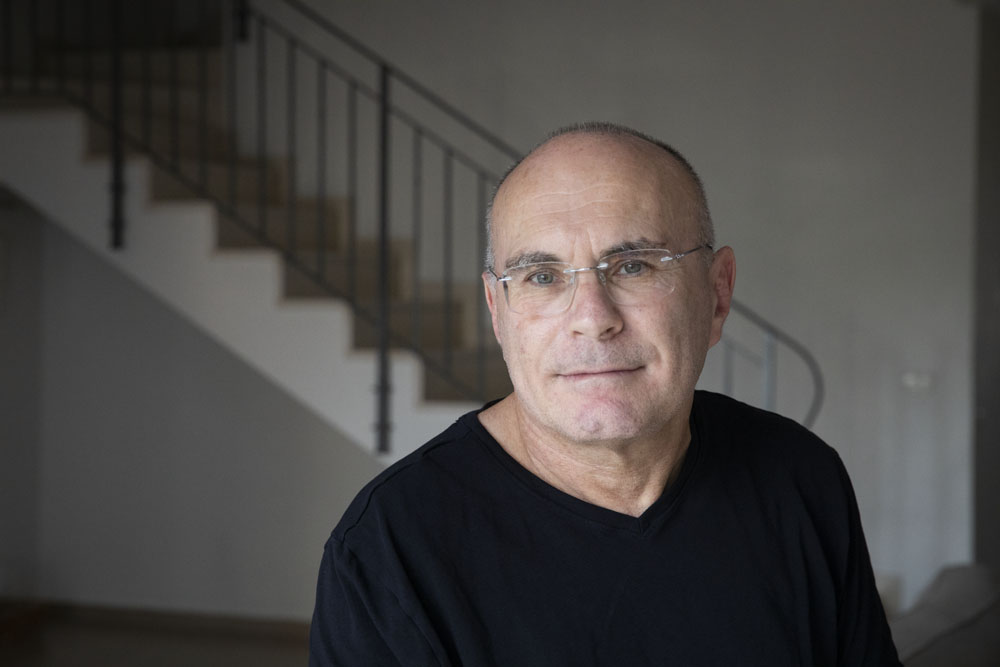 Prof. Yagil Levy in his home in Herzliya. 'In Israel, the lockdown has turned the citizens into an enemy that needs to be aggressively policed.' (Oren Ziv)