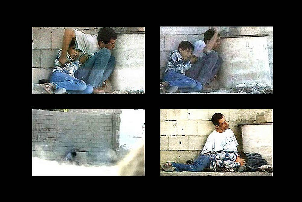 Footage taken by Talal Abu Rahma shows Jamal al-Durrah trying to protect his son, Muhammad, on September 30, 2000. (France 2/Wikimedia)
