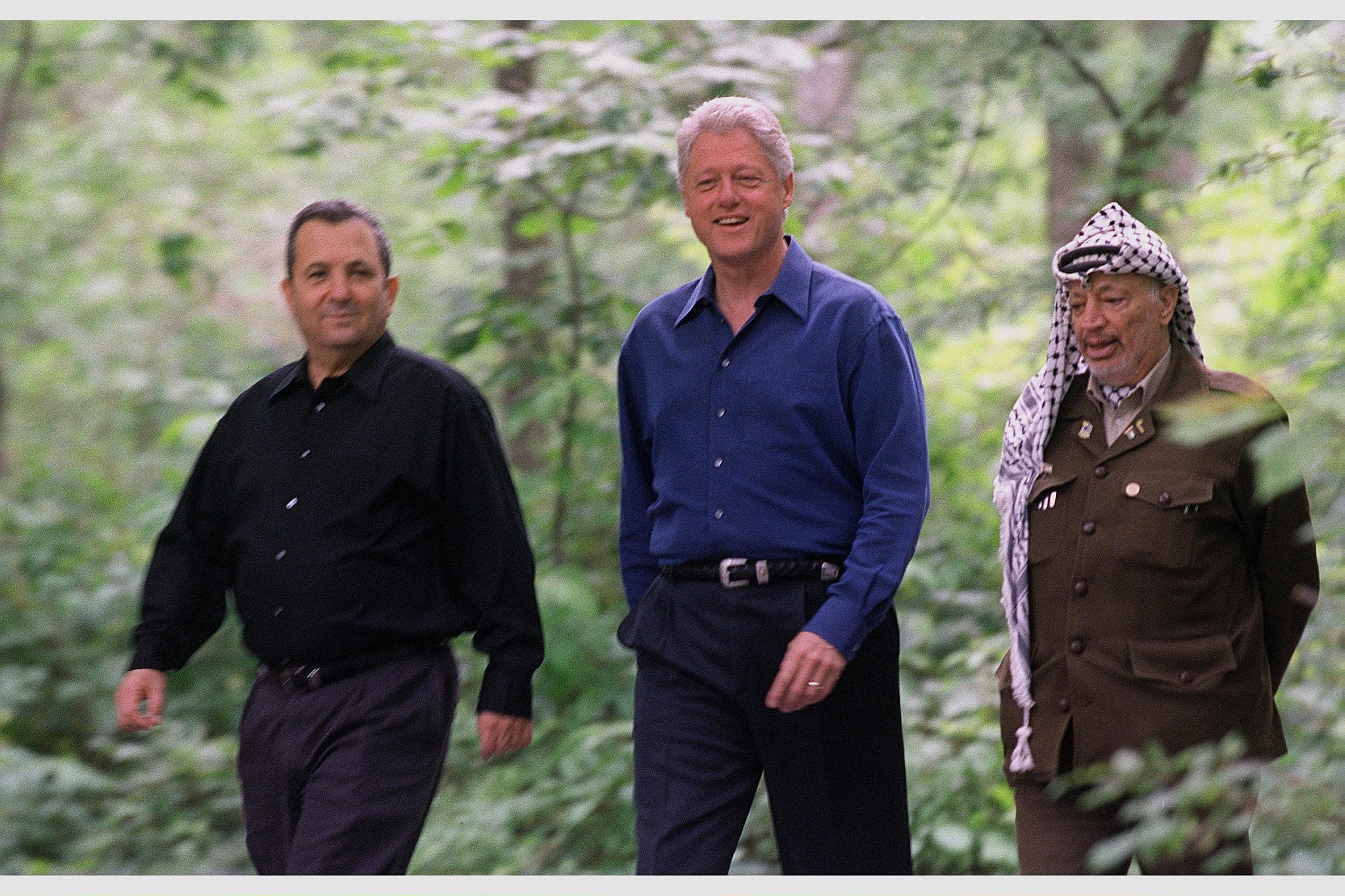 Israeli Prime Minister Ehud Barak, U.S. President Bill Clinton and PLO Chairman Yasser Arafat at the opening of the Camp David Summit in the United States, July 11, 2020. (Avi Ohayon/GPO)